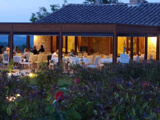 Romantic dinner in the splendid tuscan countryside with view over San Gimignano Siena