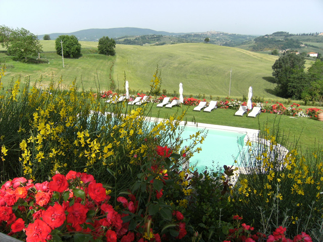 The park of romantic farmhouse Taverna di Bibbiano in San Gimignano is rich in flowers and Lavender fields
