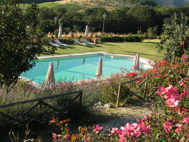 The park of farmhouse Taverna di Bibbiano in San Gimignano Tuscany has many romantic corners between flowers, rose gardens, lavender fields, panoramic points on San Gimignano