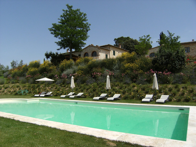 romantic Swimming Pool in Farmhouse Taverna di Bibbiano in Tuscany San Gimignano: a pictoresque cozy place surrounded by flowers