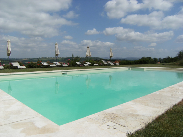Wide and Beautiful Swimming Pool in the romantic Farmhouse Taverna di Bibbiano in  San Gimignano Tuscany