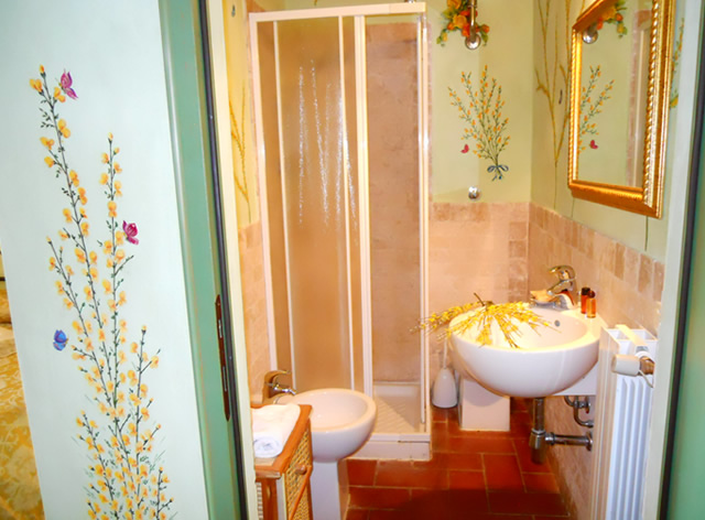 Book your romantic holiday in Tuscany in Room Le Ginestre in Romantic Farmhouse Taverna di Bibbiano San Gimignano Siena
